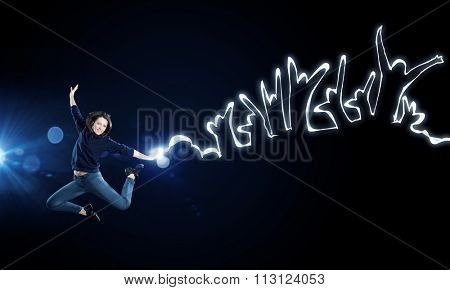 Young girl jumping high in sky representing youth concept