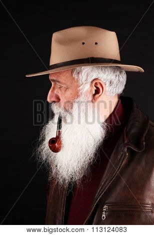 Bearded man with hat and tobacco pipe