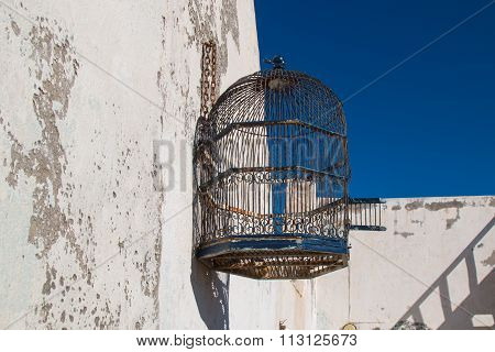 Cage On The Roof And Blue Sky