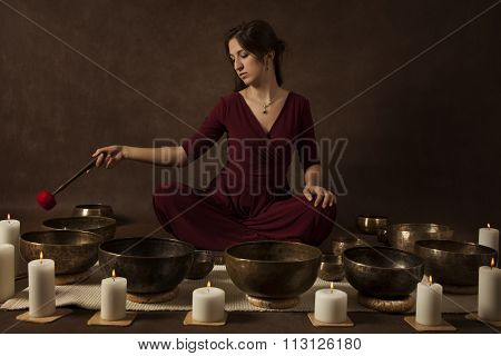 Woman Playing Tibetan Bowls
