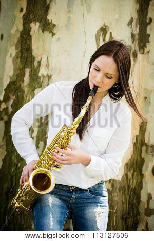 Playing saxophone in nature