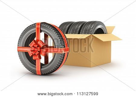 Concept Tire Gift Or Discount. Three Tires In An Open Cardboard Box On A White Background Isolation