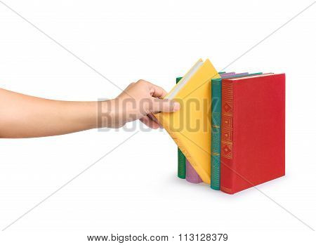 A Female Hand Picks A Book From The Bright Stack Of Vintage Book Isolated On White Background