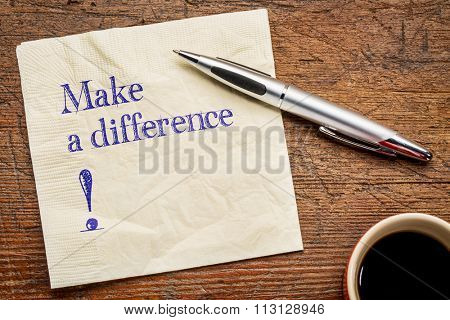 Make a difference! A motivational  text on a napkin with a cup of coffee