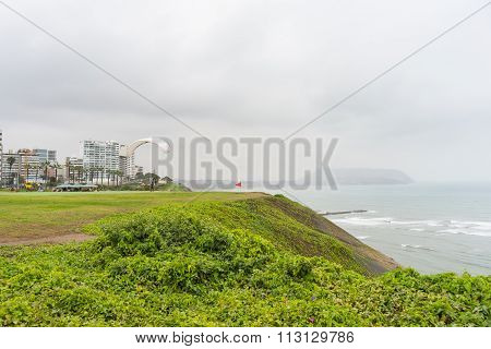 Paraglider Launching From The Coastline In Lima Miraflores
