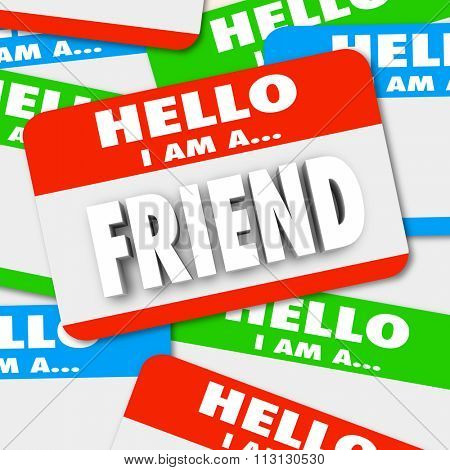 Friend word symolizing friendship on a nametag sticker in a pile of name tag badges