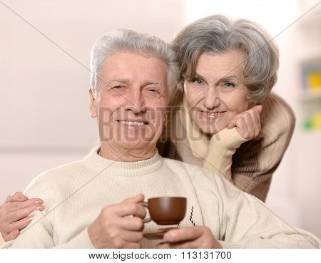 beautiful older couple with coffee
