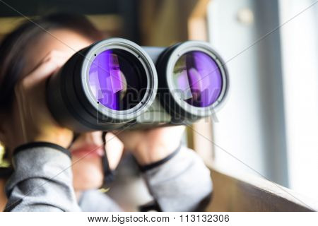 Woman looking though binoculars