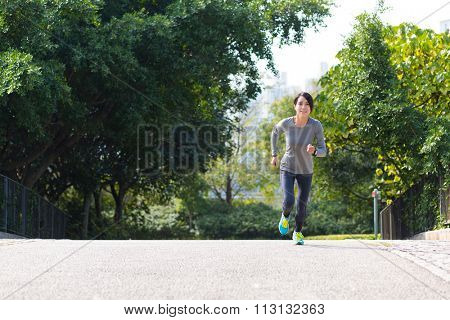 Woman running at park