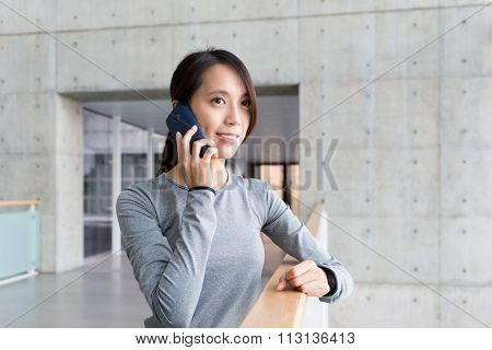 Woman talk to mobile phone at indoor