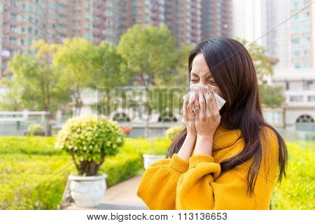 Young Woman sneeze at outdoor