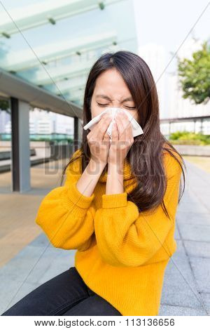 Woman sneeze when feeling unwell