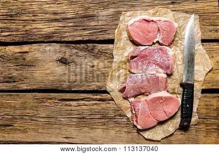 Medallions Of Fresh Raw Meat And The Carving Knife.