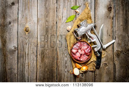 Fresh Raw Meat In A Onion With Chopper, Knife And Spices On Old Fabric.
