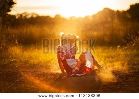 little girl playing in the dust at sunset ** Note: Visible grain at 100%, best at smaller sizes
