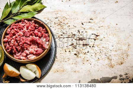 Minced Meat In A Wooden Bowl With Spices And Oil.