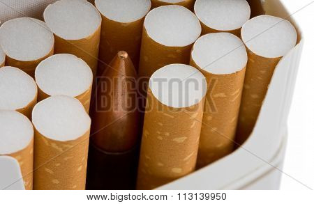 Bullet In Cigarette Pack Isolated On White