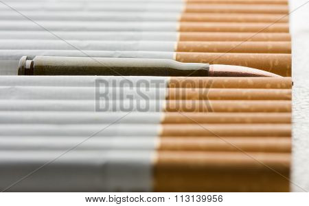 Machine Gun Cartridge And Cigarettes