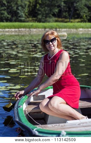 Lady in red is holding water lily