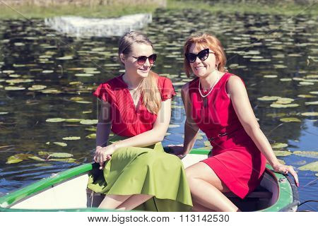 Two women have fun in the boat