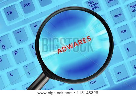 Magnifying Glass On Computer Keyboard With Words.