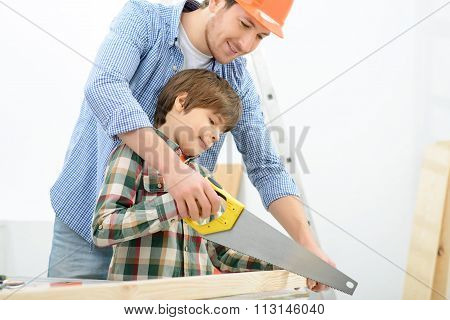 Positive father and son doing renovation