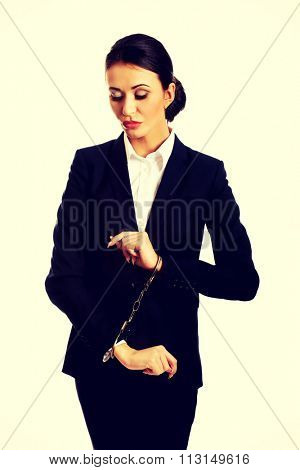 Arrested guilty businesswoman with handcuffs.