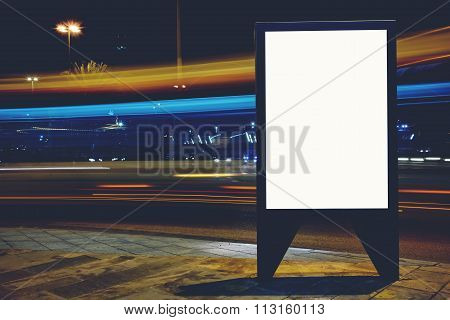 Advertising mock up banner on roadside in night public information