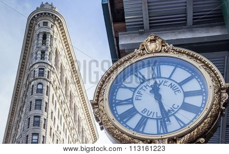 Clock And The Flatiron Building In New York City