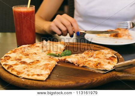 Eaten Pizza And Glass Of Tomato Juice On The Table In The Pizzeria