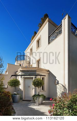 Architecture, white facade of a luxury house, entry door