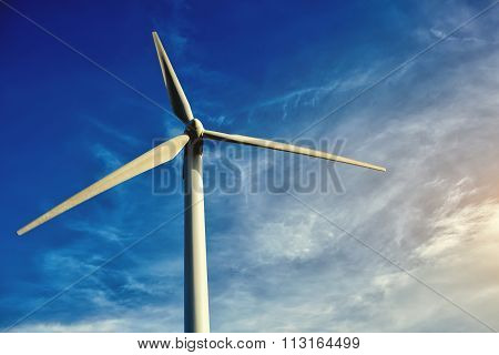 Alternative and renewable energy resources windmill located outside the city