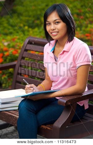 Cute Asian Student Campus Bench Studying