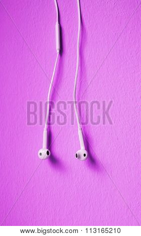 earplugs hanging on colorful background