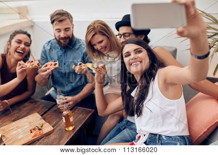 Taking A Selfie During A Pizza Party