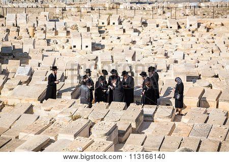 Orthodox Jews Praying On The Mount Of Olives Cemetery, Jerusalem