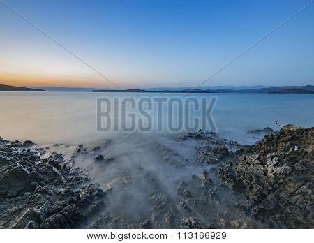 Rocks and sea during sunset at Mediterranean Sea Shore
