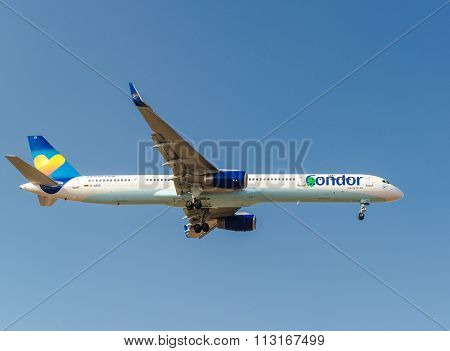 Tenerife, Spain - January 4, 2015: A Condor Airplane In The Blue Sky. Condor Is Germany's Third Larg