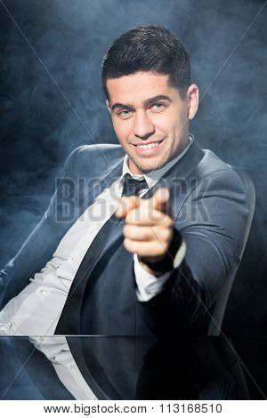 Businessman With Index Finger Pointing