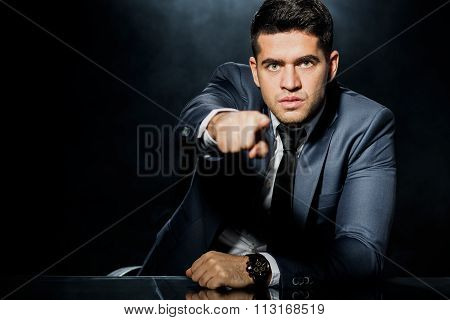 Serious Man With Finger Pointing