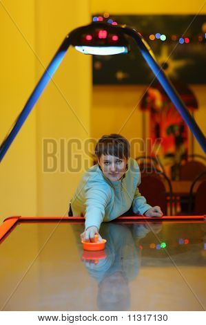 Woman Is Playing By Air Hockey