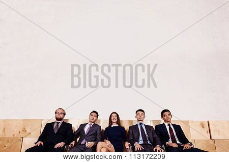 Multi ethnic group of successful workers waiting for start business meeting