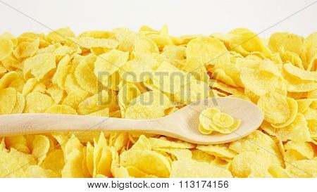 The tasty golden corn flakes with the wooden spoon