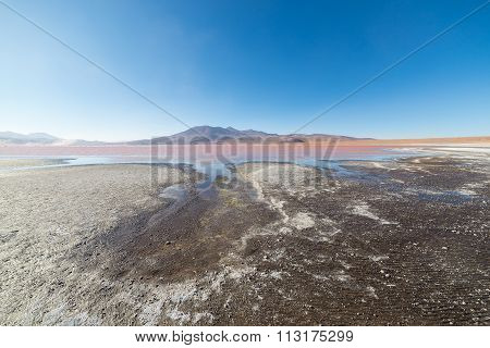 Multicolored Salt Lake With Volcano On The Bolivian Andes