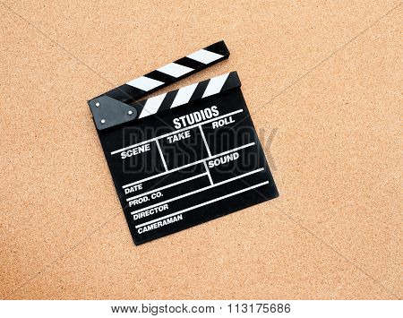 Black Movie Clapper Board On Wooden Background