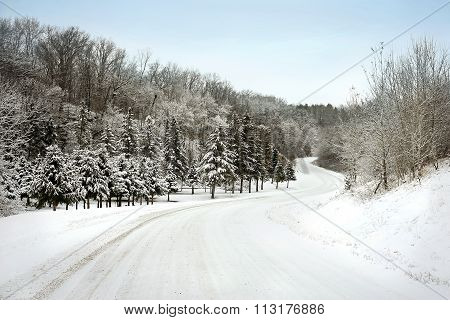 Icy Snow Covered Country Road in Winter