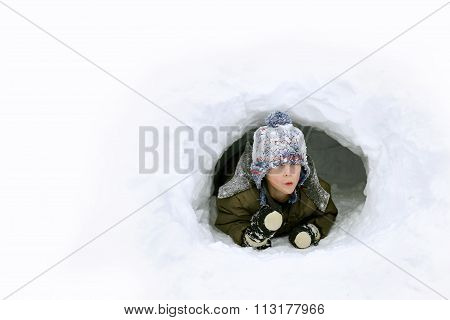 Cute Kid Playing Outside In Winter Snow Fort