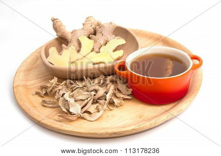 Ginger Tea And Ginger Root On A Wooden Background