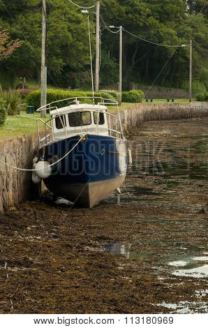 Beached boat at low tide