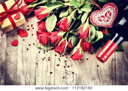St Valentine's Setting With Red Roses Bouquet, Present And Red Wine Bottle